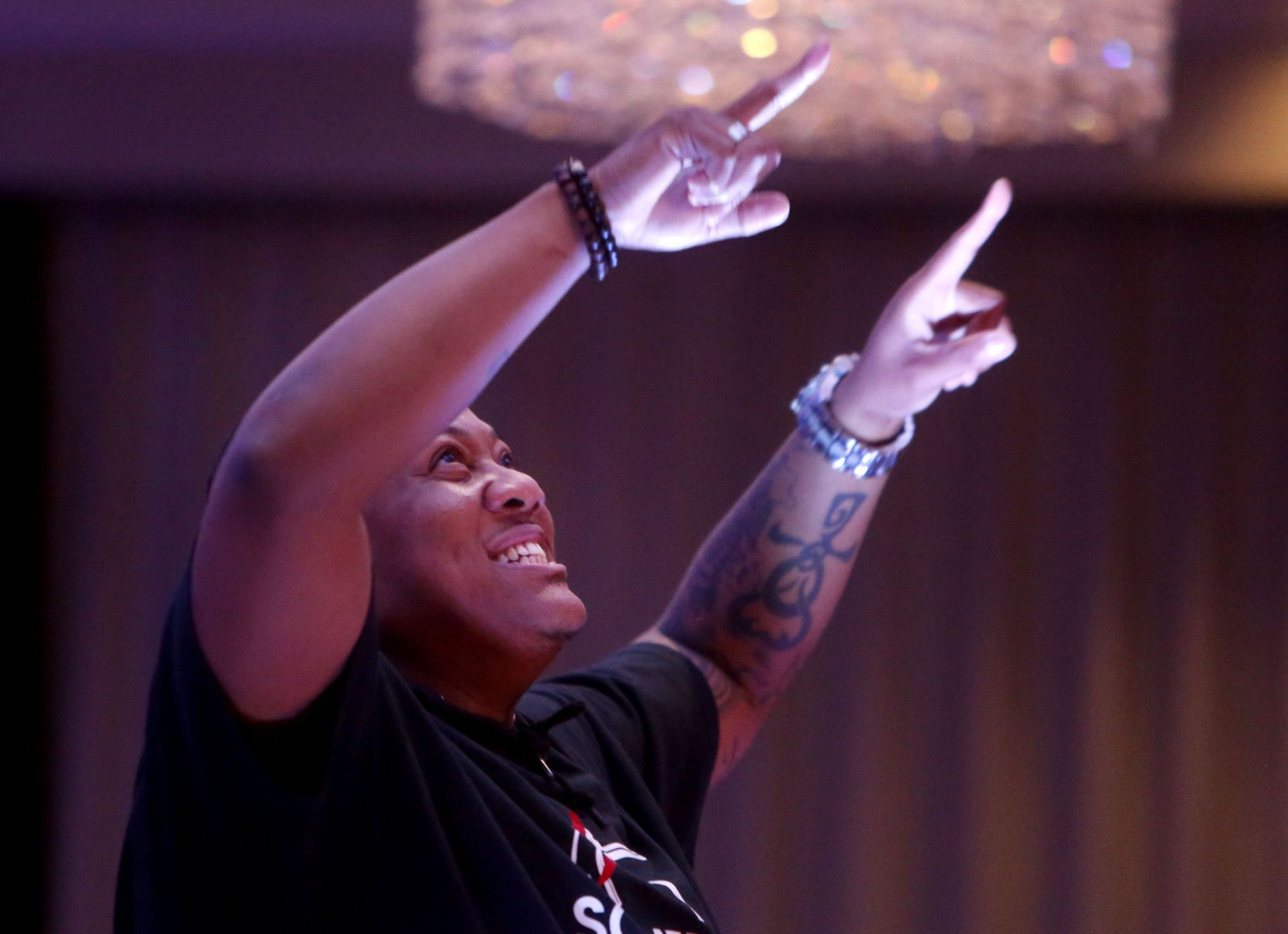 """Trenton Johnson lip-syncs to """"Glory"""" for the talent portion of the Mr. and Miss Black Trans International Pageant at the Dallas/Addison Marriott Quorum by the Galleria in Dallas on Thursday, April 27, 2017."""