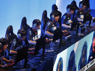 FILE — The Dallas Fuel team competes against the Houston Outlaws in their Overwatch League match at Esports Stadium Arlington Friday, July 9, 2021. Dallas Fuel defeated Houston in The Battle for Texas, 3-0. It was the first in-person live competition for fans in over a year. Houston competed from their hometown.