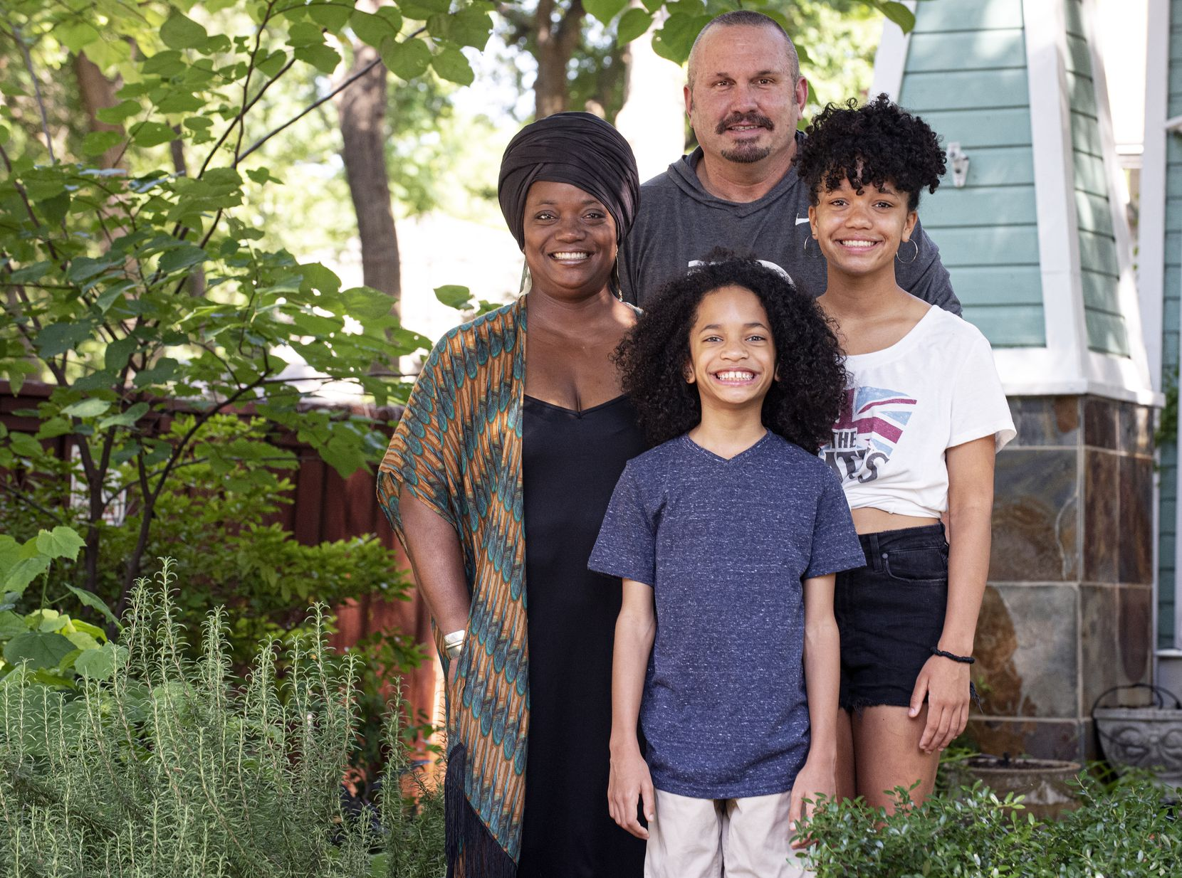 Scott Nady, Director of Recruiting for football at Southern Methodist University, with his family, wife Ronnica Nady, and children Max Nady and Phoenix Nady, outside their home in Dallas, June 09, 2020. Nady has been attending the Dallas protests with his family supporting the Black Lives Matter movement.