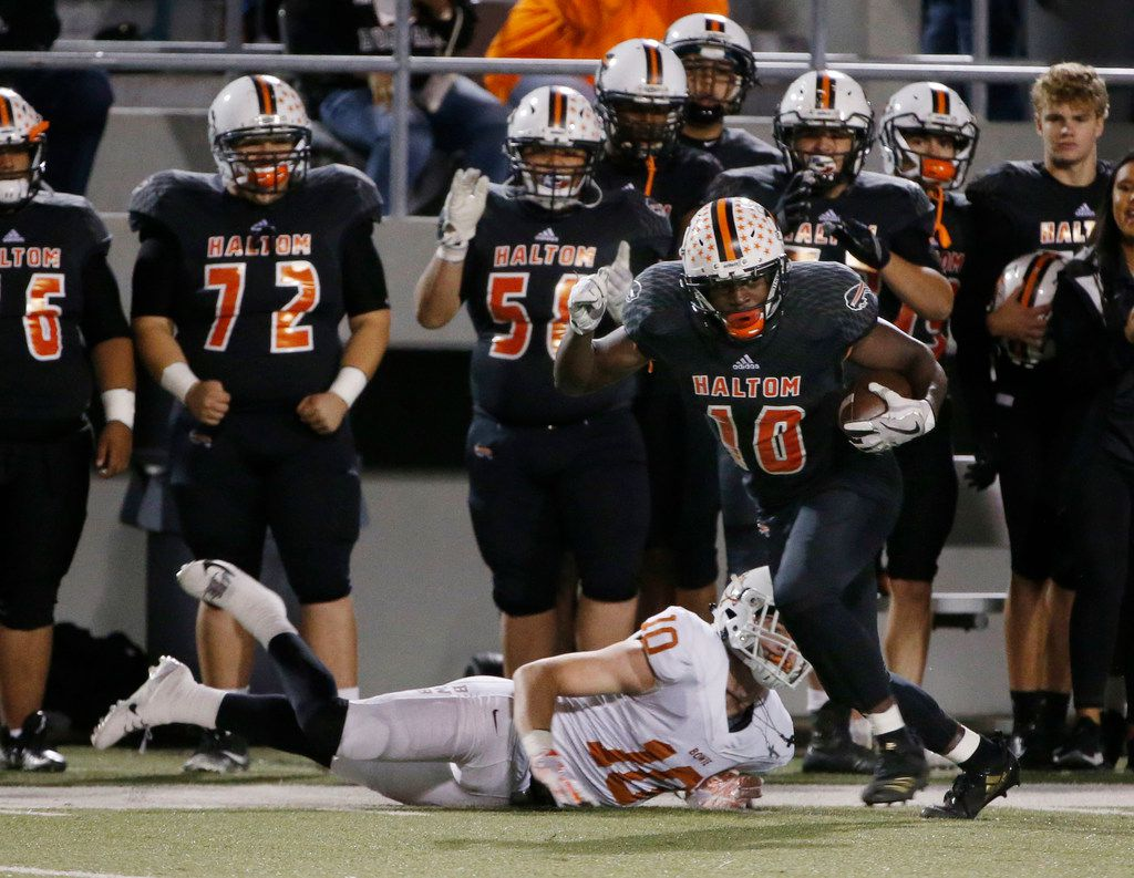 Haltom's Adam Hill runs after catching a pass against Arlington Bowie in the playoffs last year. Hill is moving to quarterback this season. (Michael Ainsworth/Special Contributor)