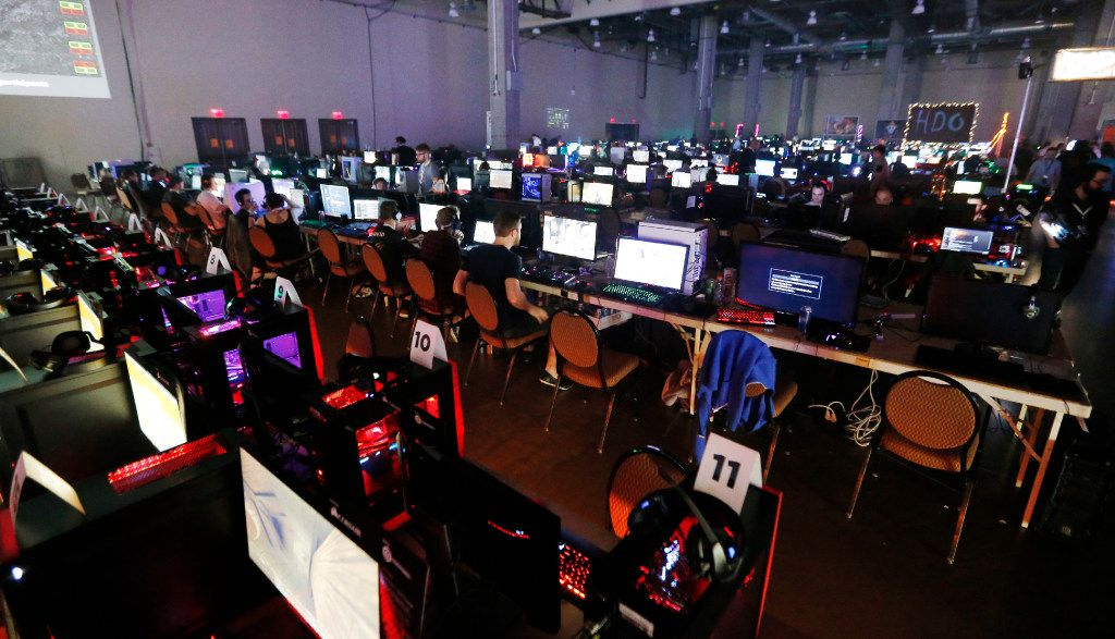 Gamers compete against each other in various multiplayer games during QuakeCon at the Gaylord Texan Resort and Convention Center Thursday.