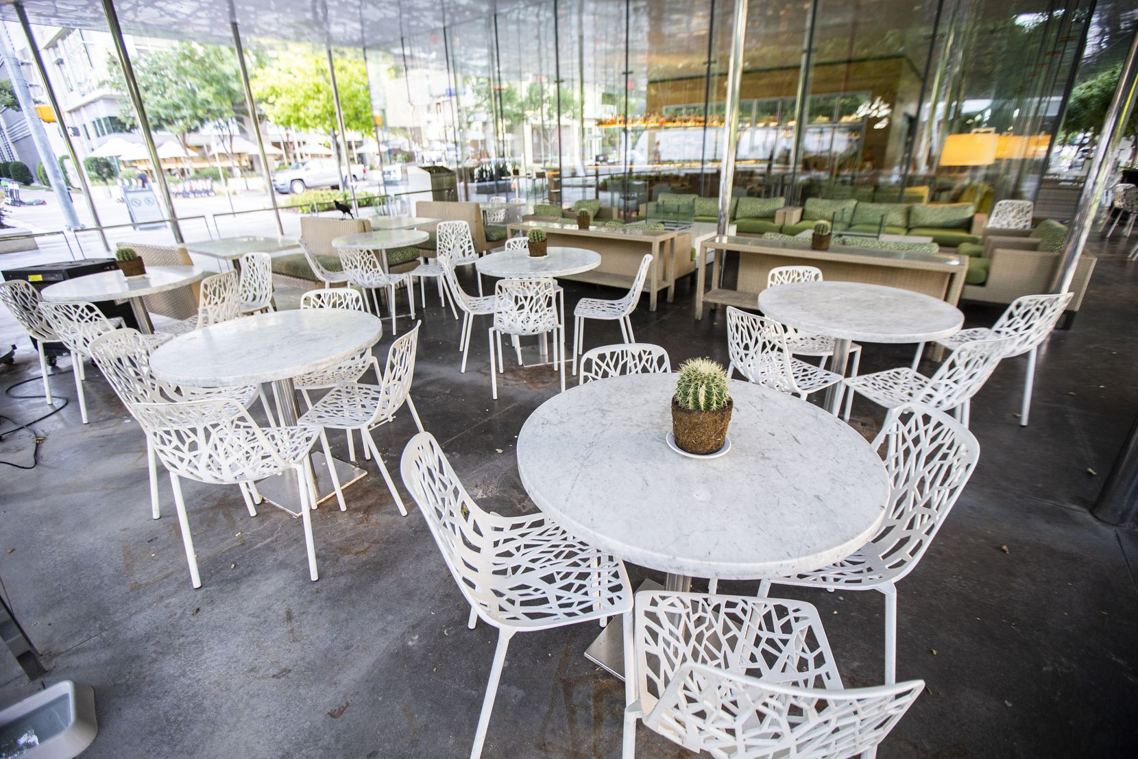 """When Savor opened in Klyde Warren Park, it got a lot of notice because of architect Tom Phifer's design, which we called """"a beautiful glass box."""""""