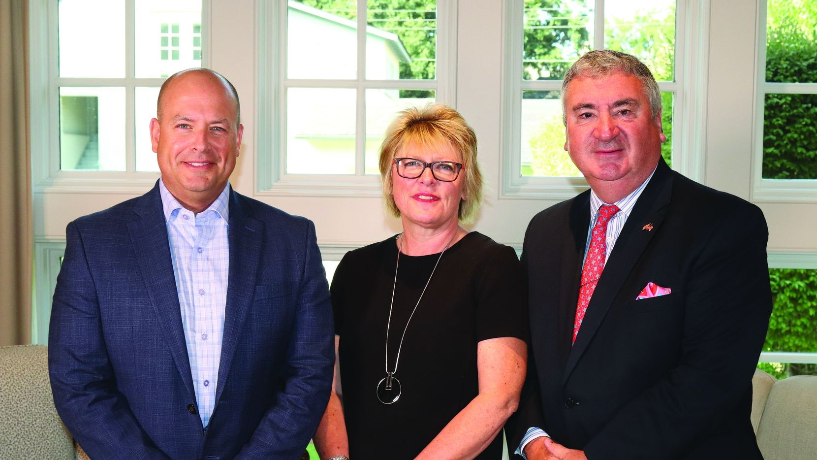 From left, Ebby Halliday Companies president and CEO Chris Kelly with Mayfair International Realty's international director Annette Reeve and managing director Nick Churton.