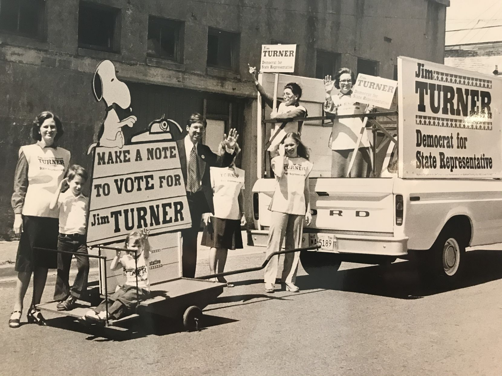 A young John Turner (left) rides a float pushing support for his father's campaign for state representative. Turner is surrounded by his mother, Ginny; sister Susan; and father Jim.