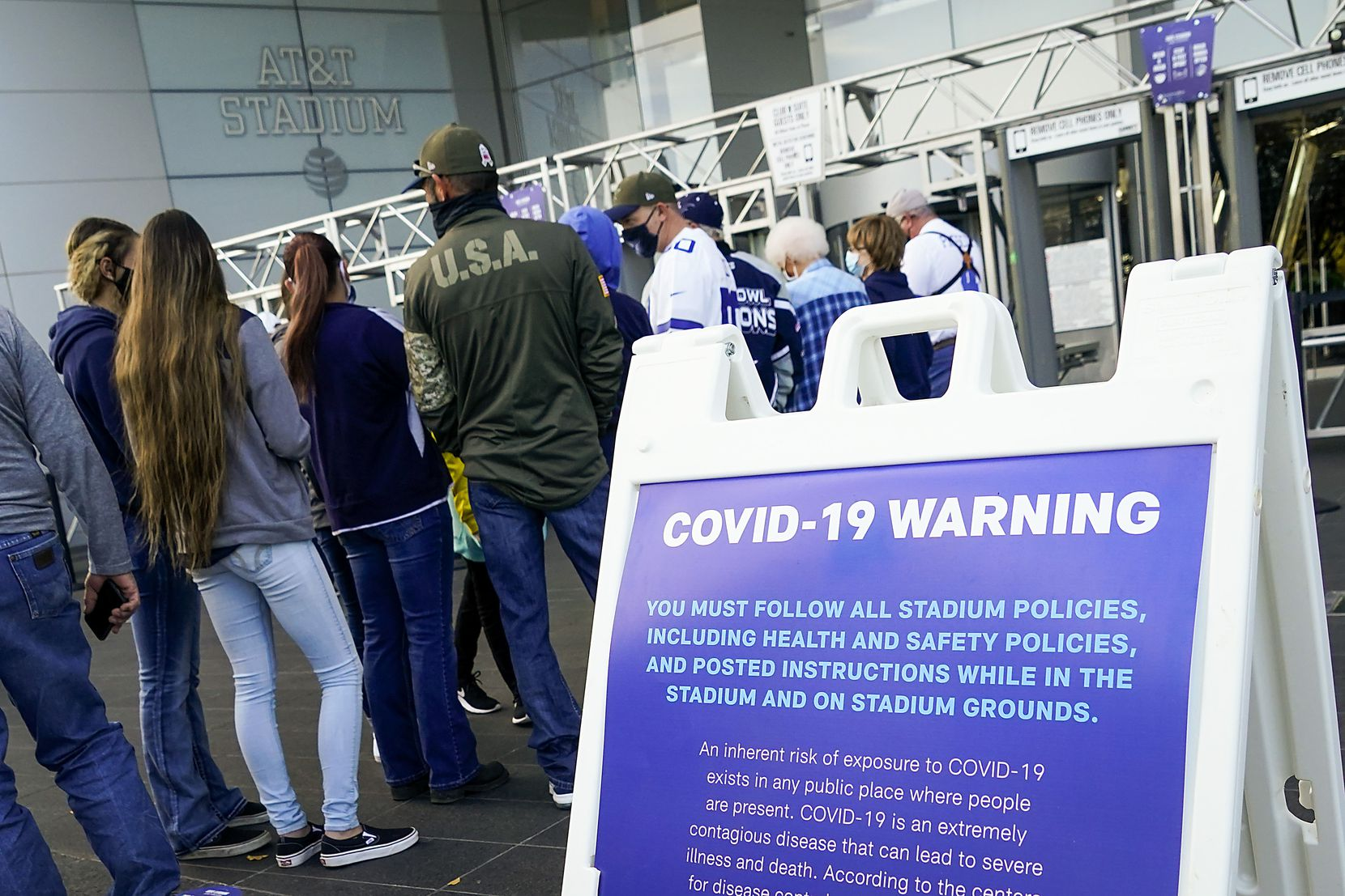 Fans wait for the gates to open before an NFL football game between the Dallas Cowboys and the Washington Football Team at AT&T Stadium on Thursday, Nov. 26, 2020, in Arlington. (Smiley N. Pool/The Dallas Morning News)