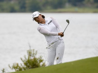 Professional golfer Jin Young Ko chips a ball onto the No. 14 green during the third round of the LPGA VOA Classic on Saturday, July 3, 2021, in The Colony, Texas. Ko finished the day at 14 under par. (Elias Valverde II/The Dallas Morning News)