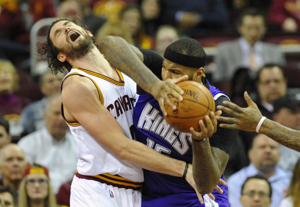 Cleveland Cavaliers forward Kevin Love (0) defends Sacramento Kings center DeMarcus Cousins (15) in the third quarter at Quicken Loans Arena.