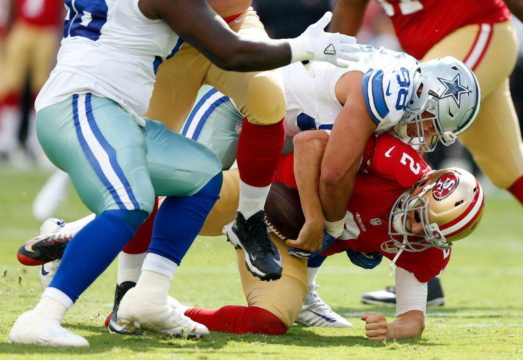 Dallas Cowboys defensive tackle Tyrone Crawford (98) sacks San Francisco 49ers quarterback Blaine Gabbert (2) during the first half of play at Levi's Stadium in Santa Clara, California on Sunday, October 2, 2016. (Vernon Bryant/The Dallas Morning News)