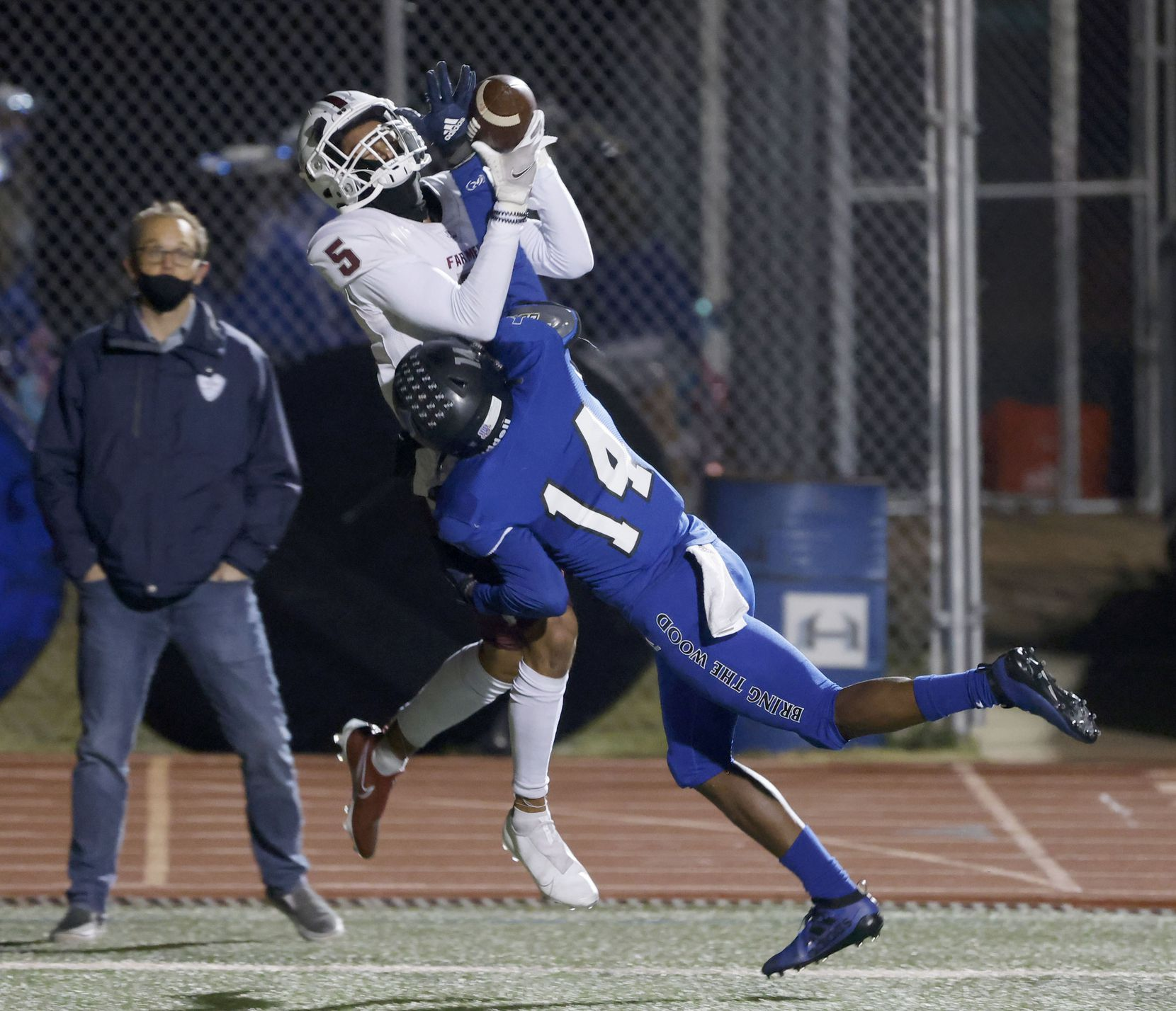 Lewisville receiver Isiah Stevens (5) makes a touchdown reception as he is defended by Hebron's Jonathan Jackson (14) during their District 6-6A high school football game on Dec. 4, 2020. (Michael Ainsworth/Special Contributor)