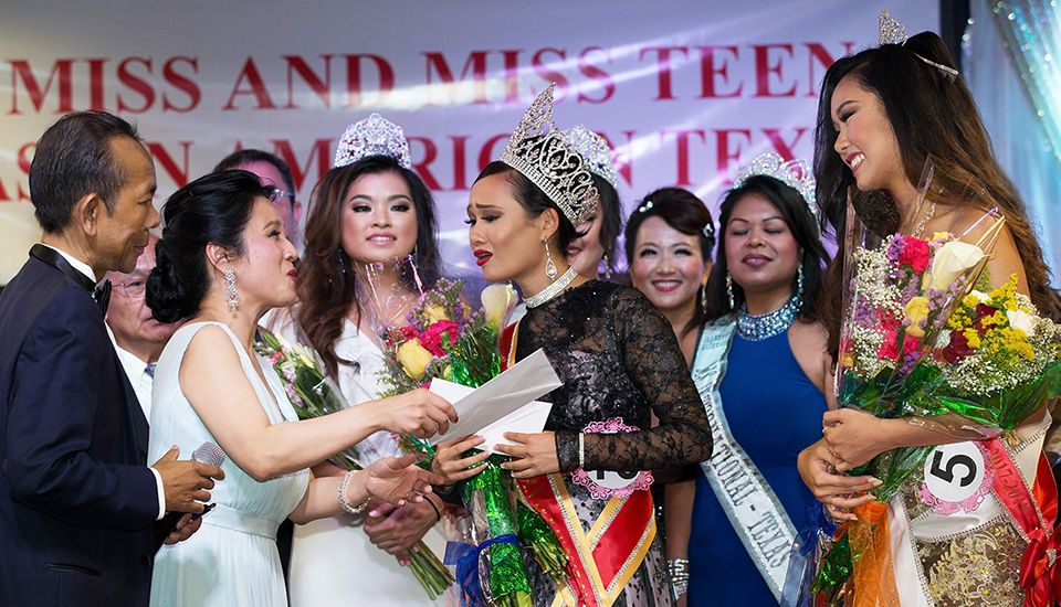 Averie Bishop reacts after being crowned Miss Asian American Texas.