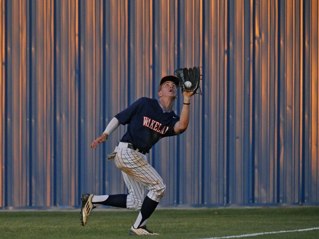 Firsco Wakeland right fielder Bryce Kozeny (18) catches a pop fly in deep right field during the second inning as Frisco Wakeland High School hosted Frisco High School at Smothermon Field in Frisco on Wednesday night, April 27, 2016. (Stewart F. House/Special contributor)