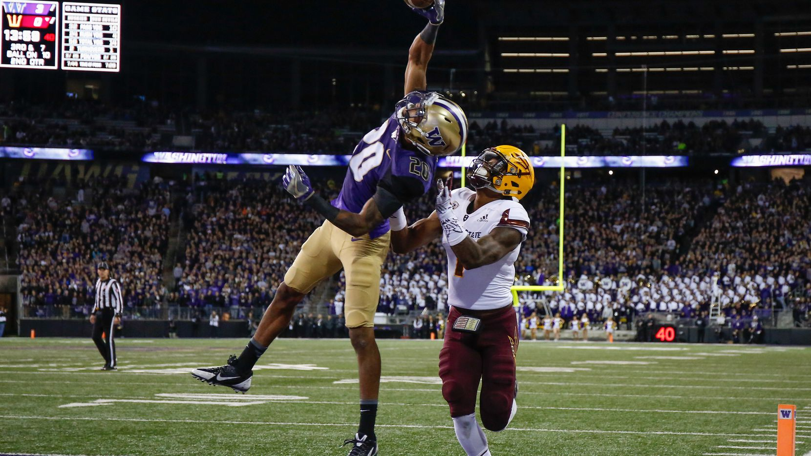 SEATTLE, WA - NOVEMBER 19:  Defensive back Kevin King (#20) of the Washington Huskies makes a one-handed interception in the end zone over wide receiver N'Keal Harry (#1) of the Arizona State Sun Devils at Husky Stadium in Seattle, Washington.  (Photo by Otto Greule Jr/Getty Images)