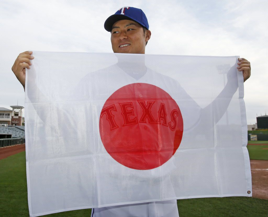 Japanese baseball player Kensuke Tanaka was among the foreign-born athletes on the Texas Rangers' roster in 2014.  (Louis DeLuca/Dallas Morning News)