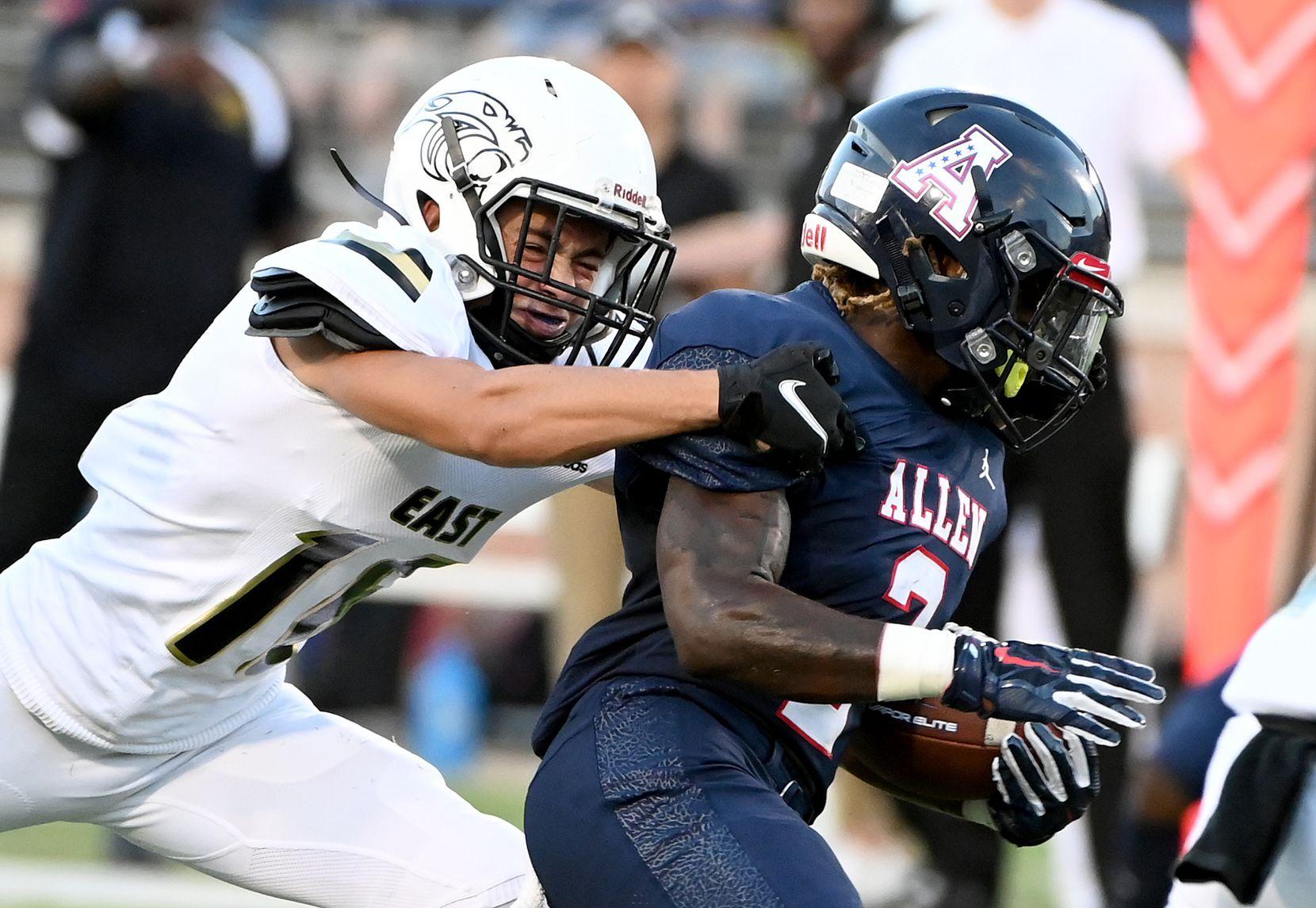 Plano East's Holden Stokes tackles Allen's Jaylen Jenkins (2) in the first half during a high school football game between Plano East and Allen, Friday, Aug. 27, 2021, in Allen, Texas. (Matt Strasen/Special Contributor)