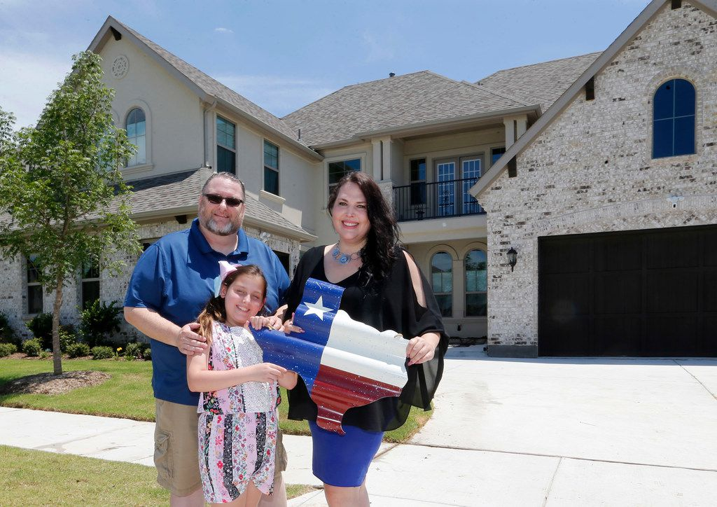Scott and Marie Bailey, with their daughter Alexandra, in front of their home at Windsong Ranch in Prosper on Tuesday, They moved in just two weeks ago.