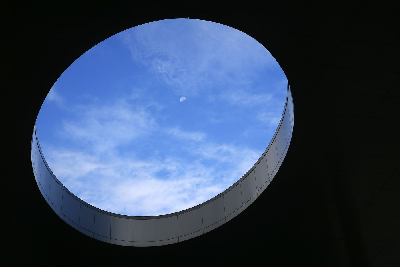 The moon is seen through the oculus.