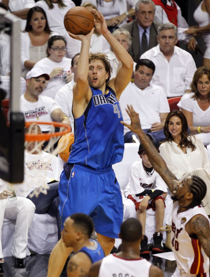 Dallas Mavericks power forward Dirk Nowitzki (41) shoots as he is defended by Miami Heat power forward Udonis Haslem (40) in the fourth quarter during Game 2 of the NBA Finals at American Airlines Arena Thursday, June 2, 2011 in Miami. Dallas defeated Miami 95-93. The series is tied 1-1. (Vernon Bryant/The Dallas Morning News)