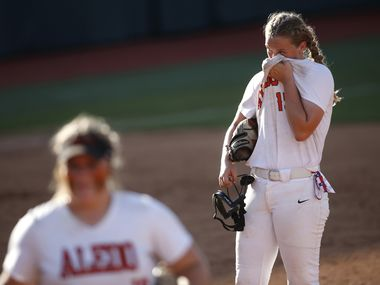 Aledo pitcher Kayleigh Smith (15) wipes away perspiration between batters during the top of the 7th inning of play against Barbers Hill. The two teams played their UIL 5A state softball championship game at Red and Charline McCombs Field on the University of Texas campus in Austin on June 5, 2021. (Steve Hamm/ Special Contributor)
