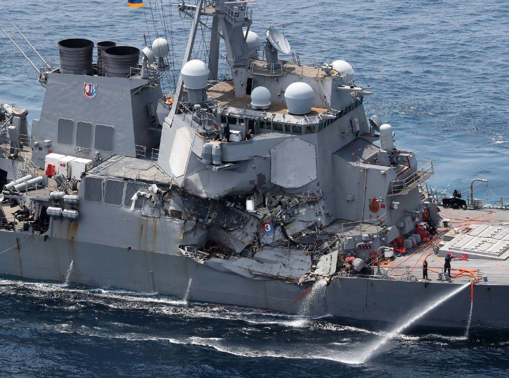 U.S. sailors found dead on destroyer after collision with ...