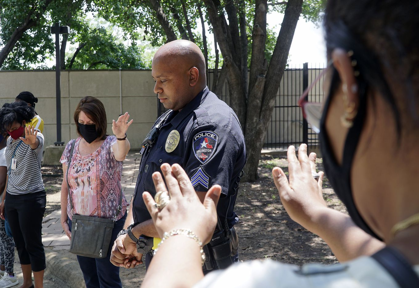 Sgt. Jeremy Lee was among several officers at a prayer for peace at police headquarters in Arlington, Texas on Tuesday, June 2, 2020.