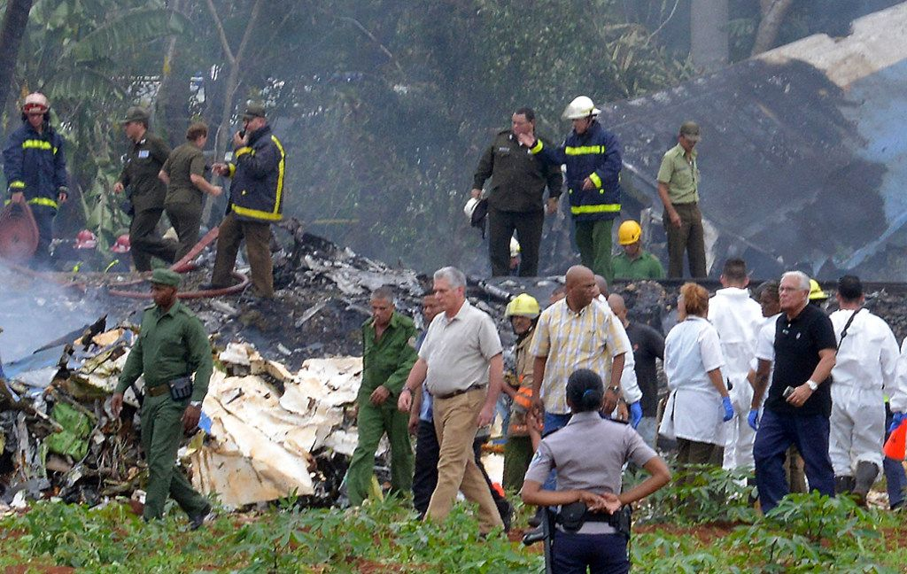 "Cuban President Miguel Diaz-Canel (C) is pictured at the site of the accident after a Cubana de Aviacion aircraft crashed after taking off from Havana's Jose Marti airport on May 18, 2018. A Cuban state airways passenger plane with 113 people on board crashed on shortly after taking off from Havana's airport, state media reported. The Boeing 737 operated by Cubana de Aviacion crashed ""near the international airport,"" state agency Prensa Latina reported. Airport sources said the jetliner was heading from the capital to the eastern city of Holguin."