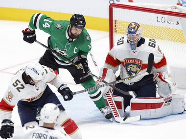 Dallas Stars left wing Jamie Benn (14) is in position to deflect the puck on Florida Panthers goaltender Chris Driedger (60) put can't get a stick on it during the third period at the American Airlines Center in Dallas, Tuesday, April 13, 2021.