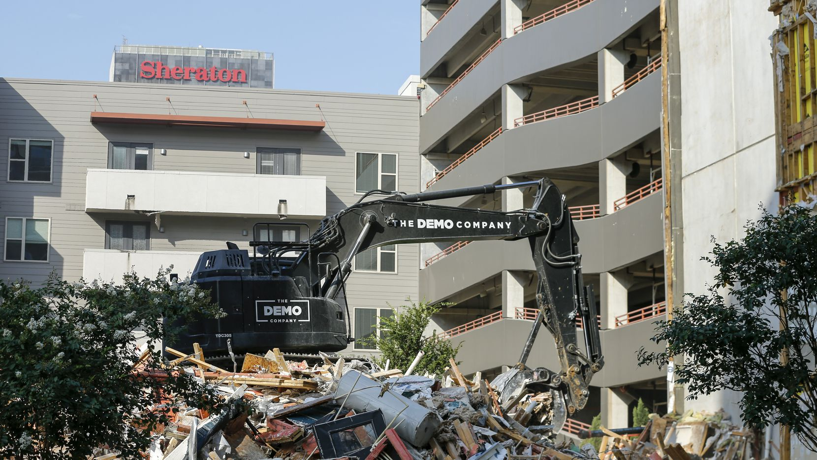An excavator cleared debris at the Elan City Lights apartments Wednesday in Dallas. A construction crane fell onto the apartment complex and garage in June 2019, killing one person and injuring five others.