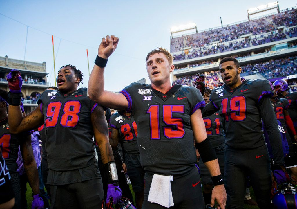 TCU Horned Frogs quarterback Max Duggan (15, center) and other players celebrate after a 37-27 TCU win over Texas on Saturday, October 26, 2019 at Amon G Carter Stadium in Fort Worth. (Ashley Landis/The Dallas Morning News)
