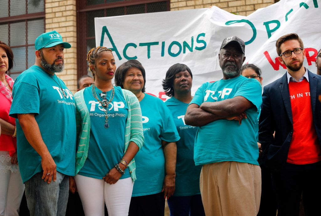 Members of TOP (Texas Organizing Project) listen to speakers at a news conference announcing the launch of Strong Schools Strong Dallas coalition, a diverse group of North Texas organizations supporting a tax ratification election.