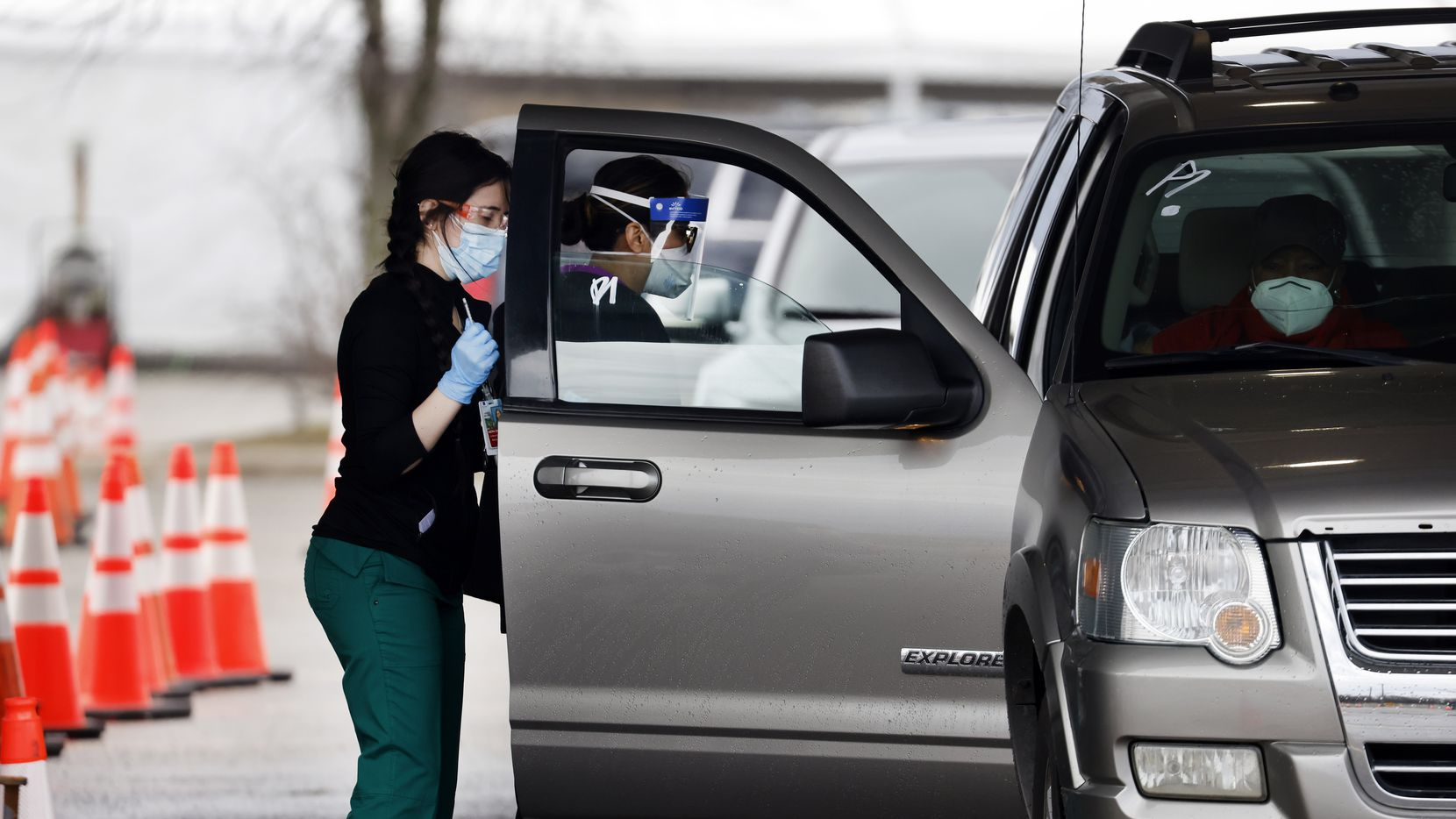 People received their COVID-19 vaccinations in a drive-through site set up outside the Ellis Davis Field House in Dallas on March 1.