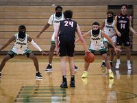 Mesquite Poteet guard Jeremiah Lynch (2), forward Tavarius Hamilton (back), guard Carlos Rodriguez (1) and guard Jeremiah Taylor (4) all wear face coverings as they setup in defense against Lovejoy guard Carson Holden (24) and forward Jeremy Van Riper (14) during a high school basketball game on Tuesday, Nov. 17, 2020, in Mesquite.