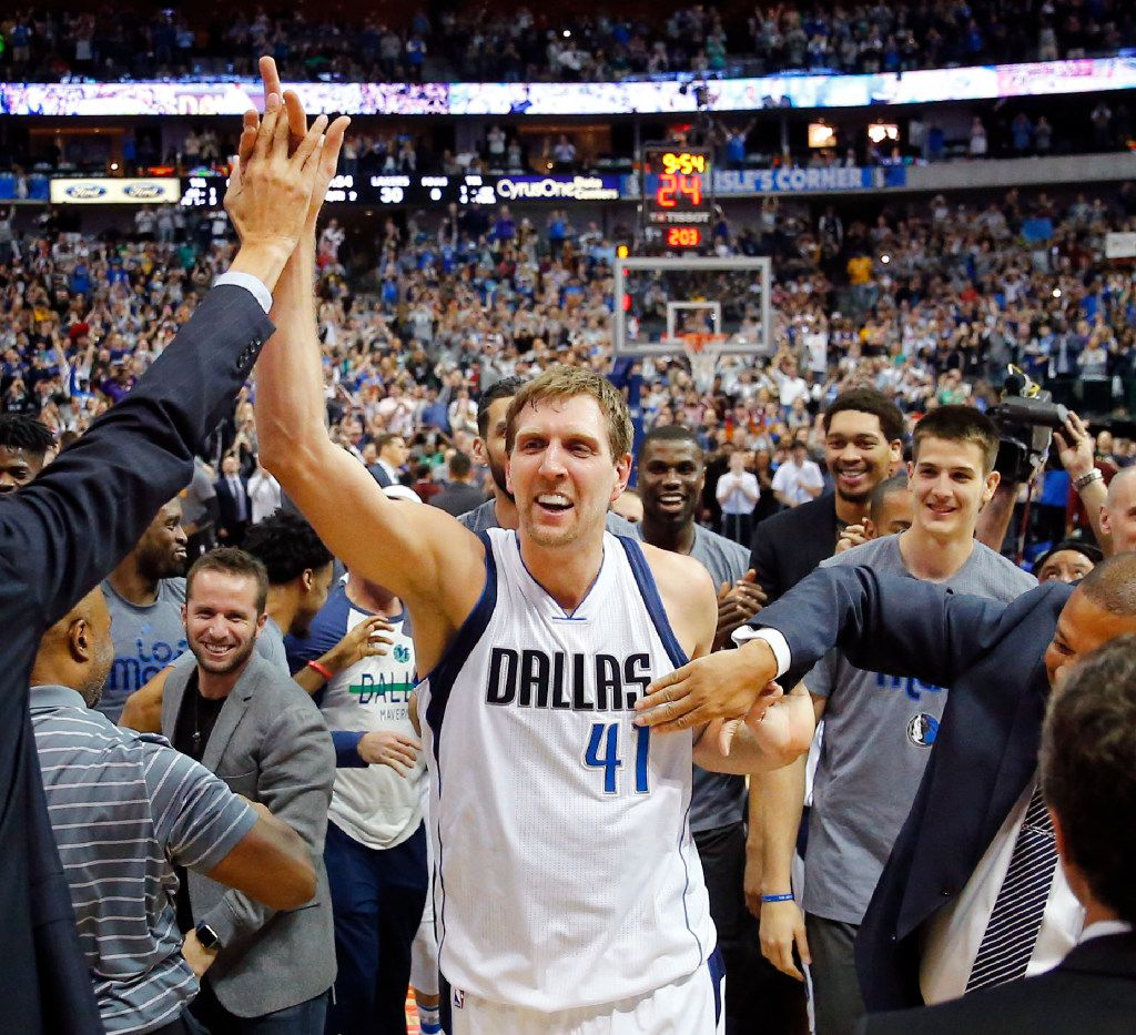 Dallas Mavericks forward Dirk Nowitzki (41) is congratulated by the team after surpassing the 30,000 point mark against the Los Angeles Lakers in the second quarter at the American Airlines Center in Dallas, Tuesday, March 7, 2017. Dirk is only the 6th player in NBA history to reach the milestone. (Tom Fox/The Dallas Morning News )