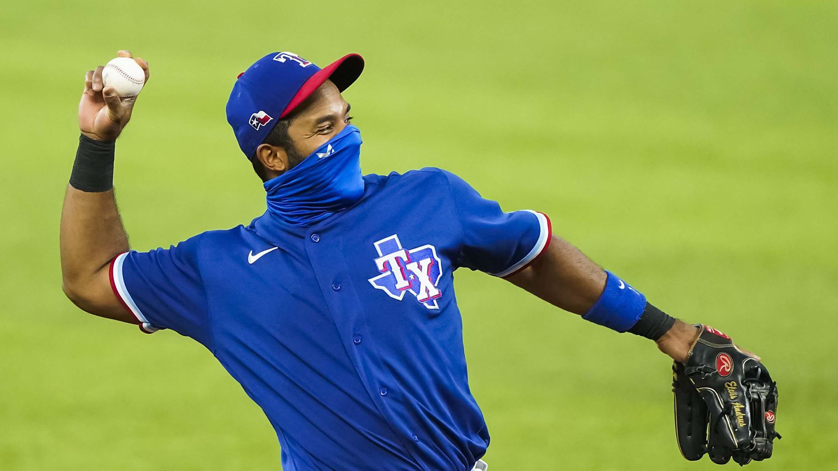 Texas Rangers shortstop Elvis Andrus wears a face mask as warms up before an exhibition game against the Colorado Rockies at Globe Life Field on Tuesday, July 21, 2020.