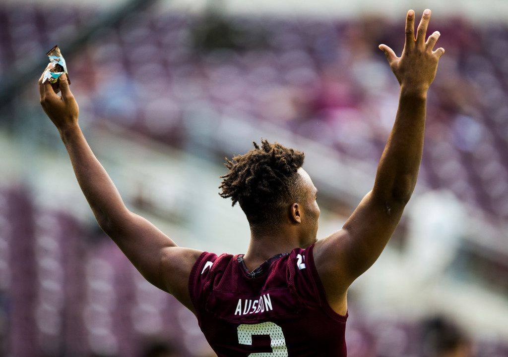 Texas A&M Aggies wide receiver Jhamon Ausbon (2) signals to other players during warm up before an NCAA football game between Kentucky and Texas A&M on Saturday, October 6, 2018 in College Station, Texas. (Ashley Landis/The Dallas Morning News)