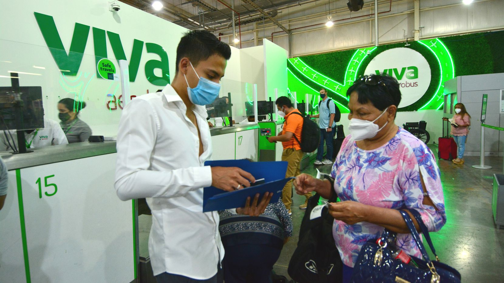 Graciela Cortés Rodríguez (right) gets her documentation checked by Abraham Serrano of MoncloTexas Tours before taking a flight from Monterrey's International Airport to DFW International Airport on Monday, September 20, 2021. (Pedro Pérez/Special Contributor.)