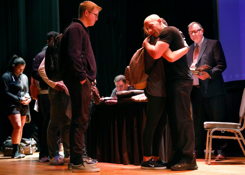 Suicide survivor, activist, storyteller and filmmaker Kevin Hines (right) comforts a student who approached him during a book signing at Ferguson Auditorium.  His keynote address was part of mental health awareness day at Texas A&M-Commerce.