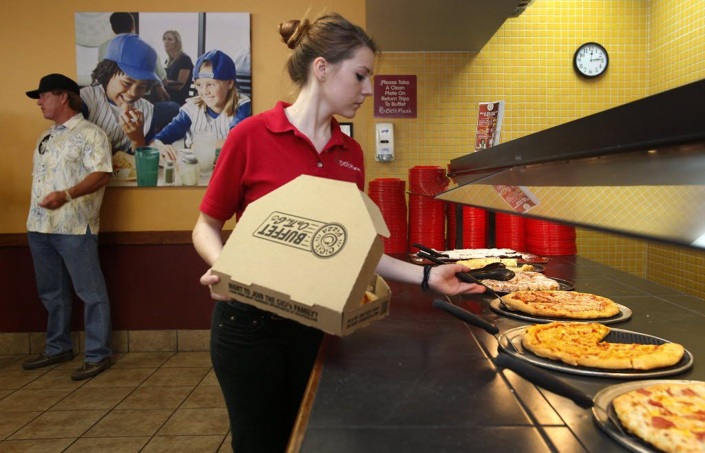 Shift leader Lisa Festger fills a to-go order at the CiCi's Pizza location on at 2220 Coit Road in Plano on June 4, 2013.