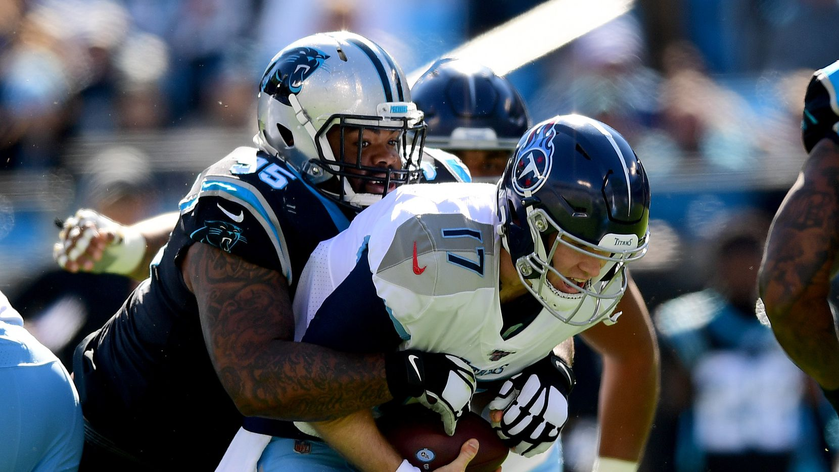 CHARLOTTE, NORTH CAROLINA - NOVEMBER 03: Dontari Poe #95 of the Carolina Panthers sacks Ryan Tannehill #17 of the Tennessee Titans in the first quarter during their game at Bank of America Stadium on November 03, 2019 in Charlotte, North Carolina. (Photo by Jacob Kupferman/Getty Images)