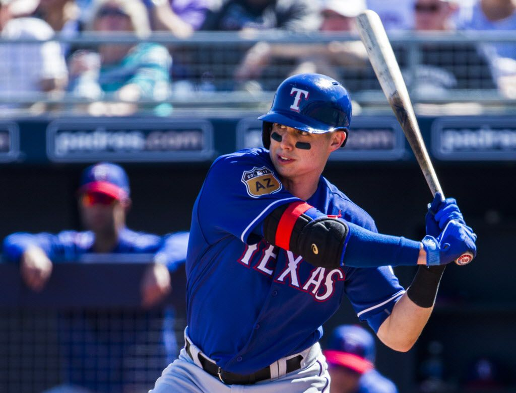 Texas Rangers third baseman Drew Robinson (68) bats during the third inning of a spring training game against the Seattle Mariners on Sunday, March 5, 2017 at the Peoria Sports Complex in Peoria, Arizona. (Ashley Landis/The Dallas Morning News)