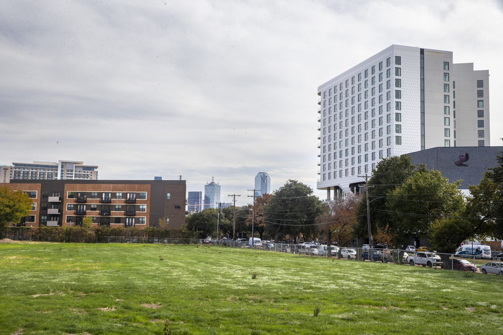 A vacant lot across from the Virgin Hotel (right) in the Dallas Design District is the site of the new apartment tower.
