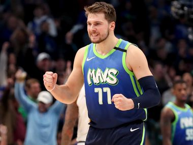 FILE - Luka Doncic reacts against the Denver Nuggets in the second half at American Airlines Center on Jan. 8, 2020 in Dallas.
