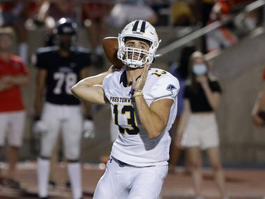 Plano Prestonwood quarterback Maguire Martin throws a pass during a 55-41 win against Coppell on Friday. He threw for 381 yards and five touchdowns. (Michael Ainsworth/Special Contributor)
