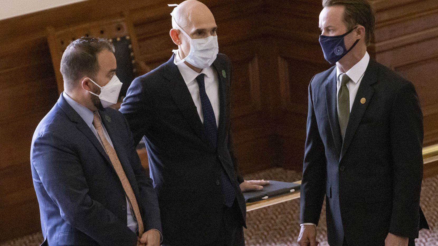 The House is lifting a requirement that members wear masks while on the floor and in committee rooms. In a file photo from mid-March, Speaker Dade Phelan (right) speaks with Reps. Joe Moody (left) and Greg Bonnen.