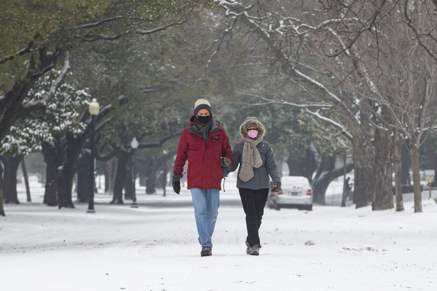 Jack Levison and Priscilla Pope-Levison take a stroll down Swiss Ave in Dallas on Wednesday, Feb. 17, 2021.