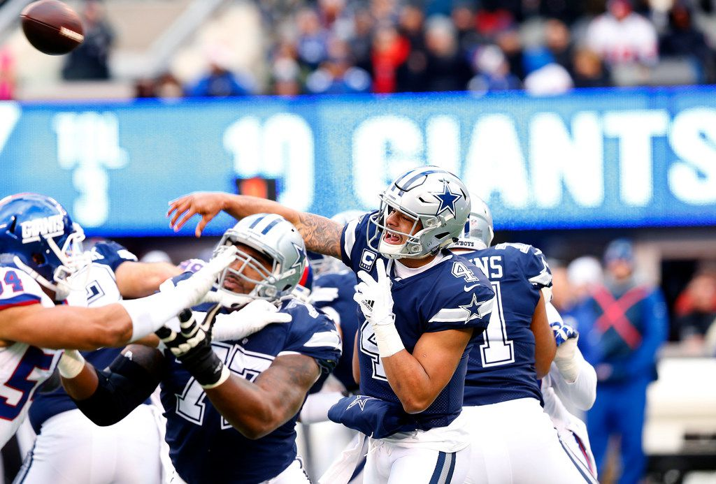 Dallas Cowboys quarterback Dak Prescott (4) throws a first half pass against the New York Giants at MetLife Stadium in East Rutherford, New Jersey, Sunday, December 10, 2017. (Tom Fox/The Dallas Morning News)