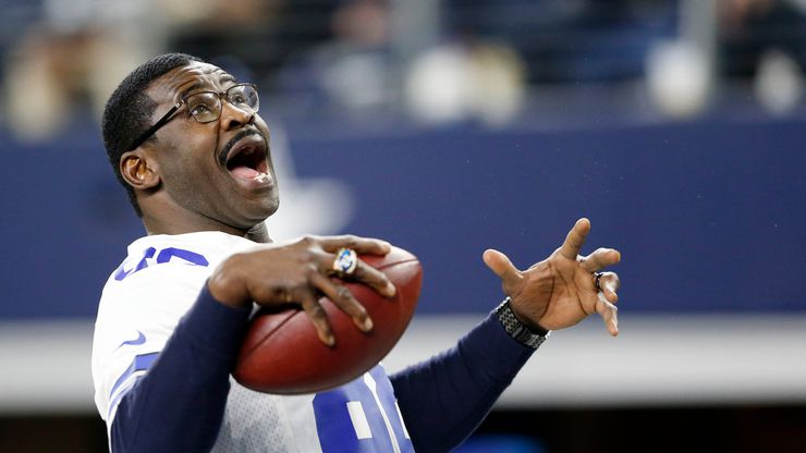 Dallas Cowboys former receiver Michael Irvin (88) plays catch with himself after being introduced before a game against the Philadelphia Eagles at AT&T Stadium in Arlington, Texas on Sunday, November 19, 2017.