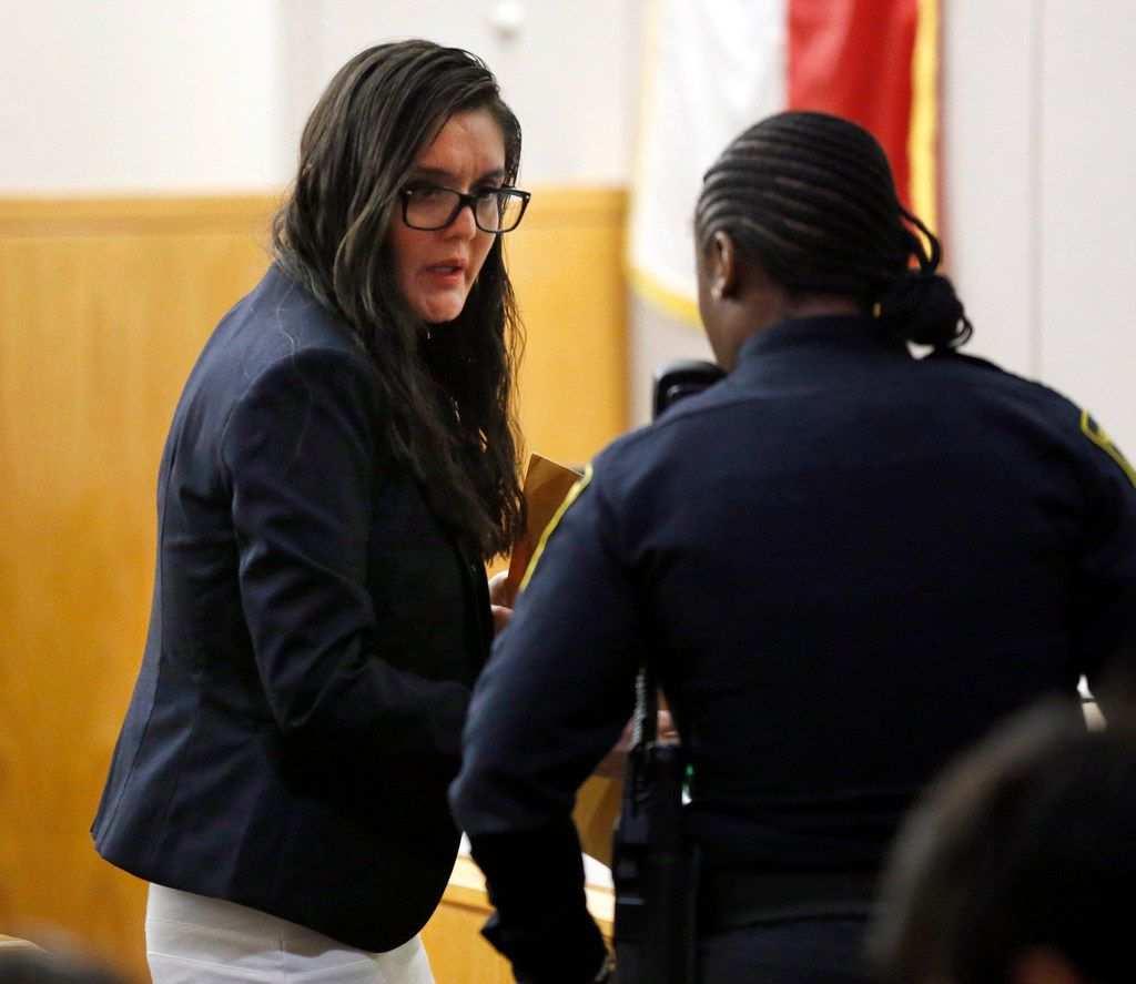 Defendant Brenda Delgado (left) asks a question of the bailiff following the first day of her murder trial in the 363rd Judicial District Court at the Frank Crowley Courthouse in Dallas, Monday, June 3, 2019. Delgado is accused of hiring Crystal Cortes and Kristopher Love to kill Kendra Hatcher, an Uptown dentist. (Tom Fox/The Dallas Morning News)