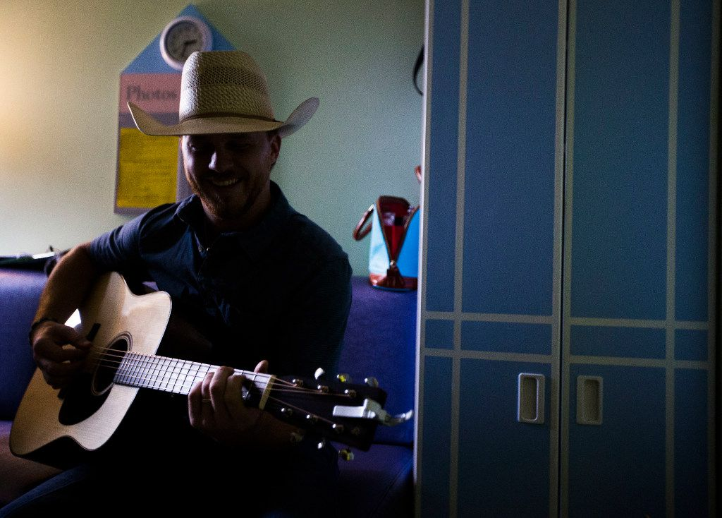 "Singer-songwriter Cody Johnson performs his hit song ""With You I Am"" for Danielle Grey at Cook Children's Medical Center on Saturday, June 24, 2017, in Fort Worth, Texas. Grey, who was diagnosed with cystic fibrosis at 3 months old, was readmitted for treatment causing her to miss Saturday's Cody Johnson concert. (Ryan Michalesko/The Dallas Morning News)"