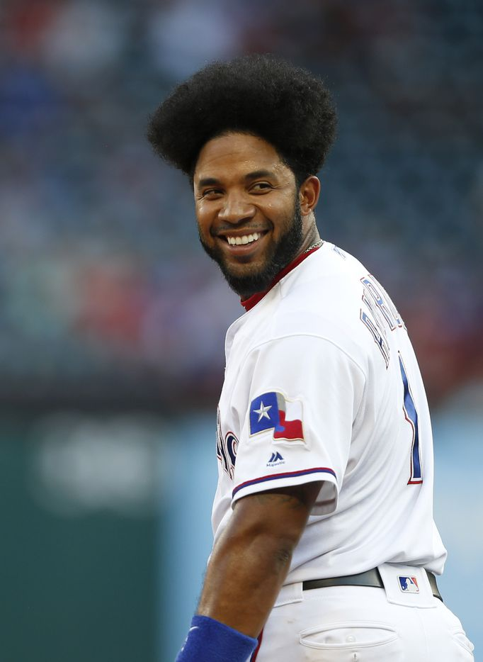 Texas Rangers shortstop Elvis Andrus (1) smiles as he looks back towards the Cleveland Indians dugout during the second inning of play at Globe Life Park in Arlington, Texas on Tuesday, June 18, 2019. (Vernon Bryant/The Dallas Morning News)