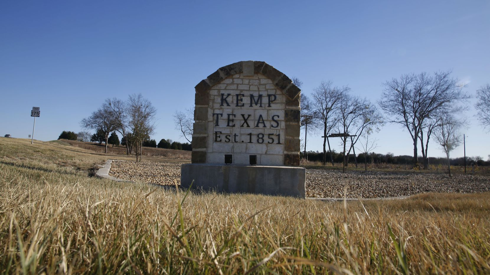 A stone marker stands at the exit from U.S. Highway 175 to Kemp, where a religious cabinetmaker was scammed by two men claiming to belong to the Illuminati.